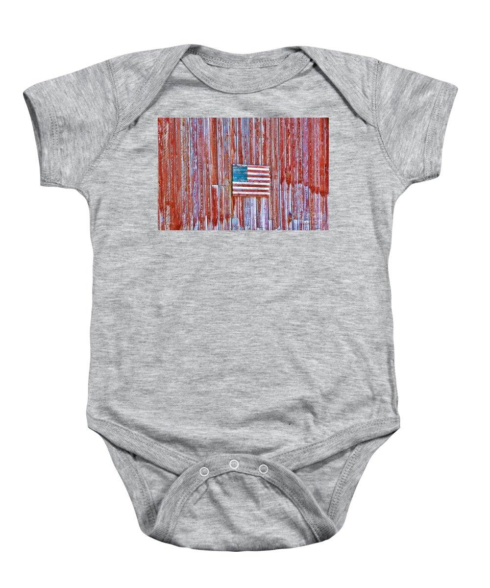 Barn Baby Onesie featuring the photograph Rural Patriot by Deborah Benoit