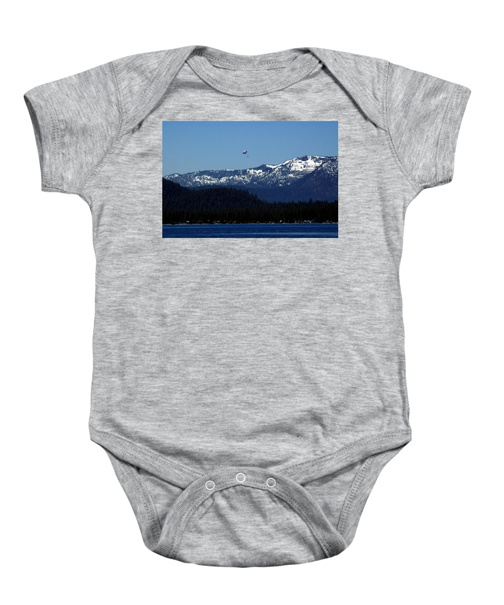 Usa Baby Onesie featuring the photograph Tahoe Parasailing by LeeAnn McLaneGoetz McLaneGoetzStudioLLCcom
