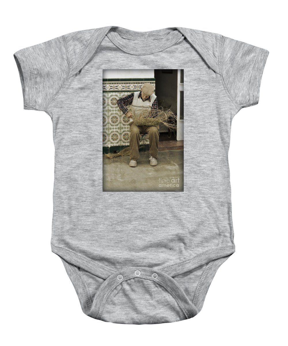 The Basket Maker Baby Onesie featuring the photograph The Basket Maker by Mary Machare