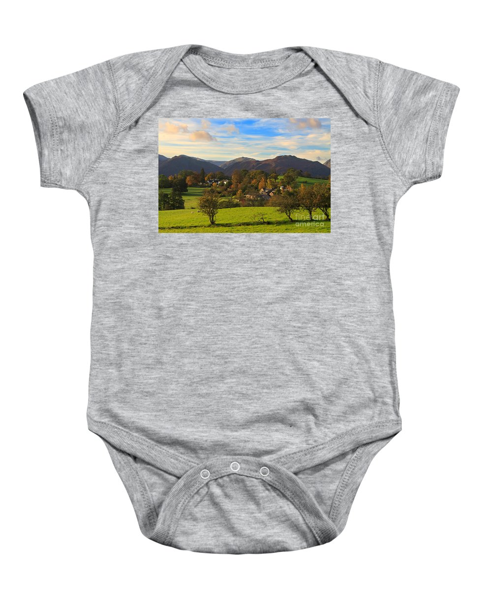 Watermillock Baby Onesie featuring the photograph The Village Of Watermillock In Cumbria Uk by Louise Heusinkveld