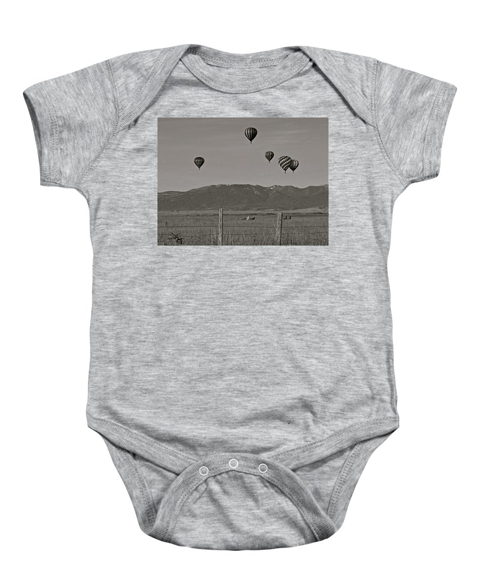 Balloons Baby Onesie featuring the photograph Unconcerned Lamas by Eric Tressler