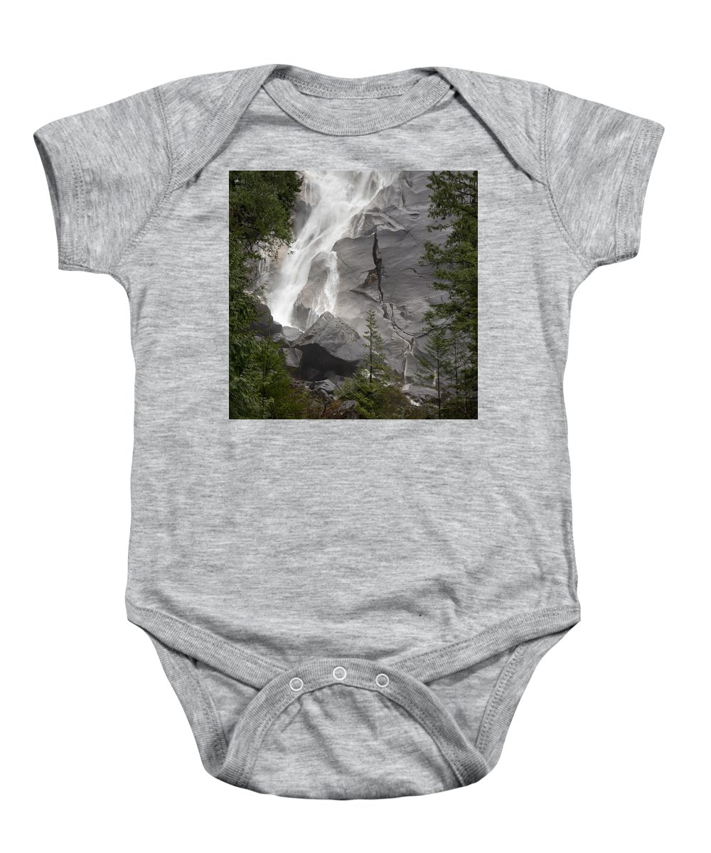 Blur Baby Onesie featuring the photograph Water Cascading Down The Rock And by Keith Levit