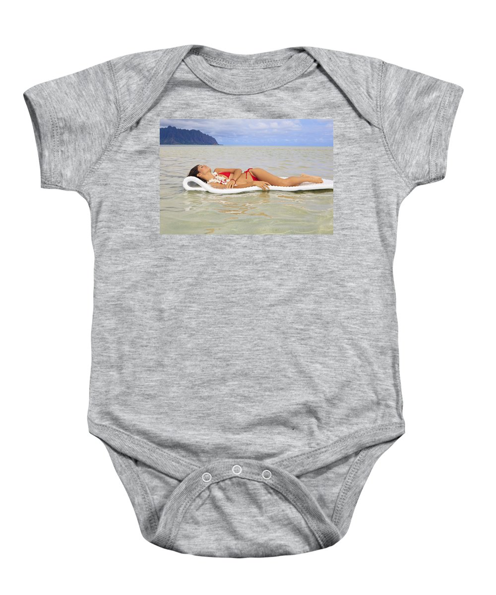 Amazing Baby Onesie featuring the photograph Woman On Raft by Tomas del Amo - Printscapes