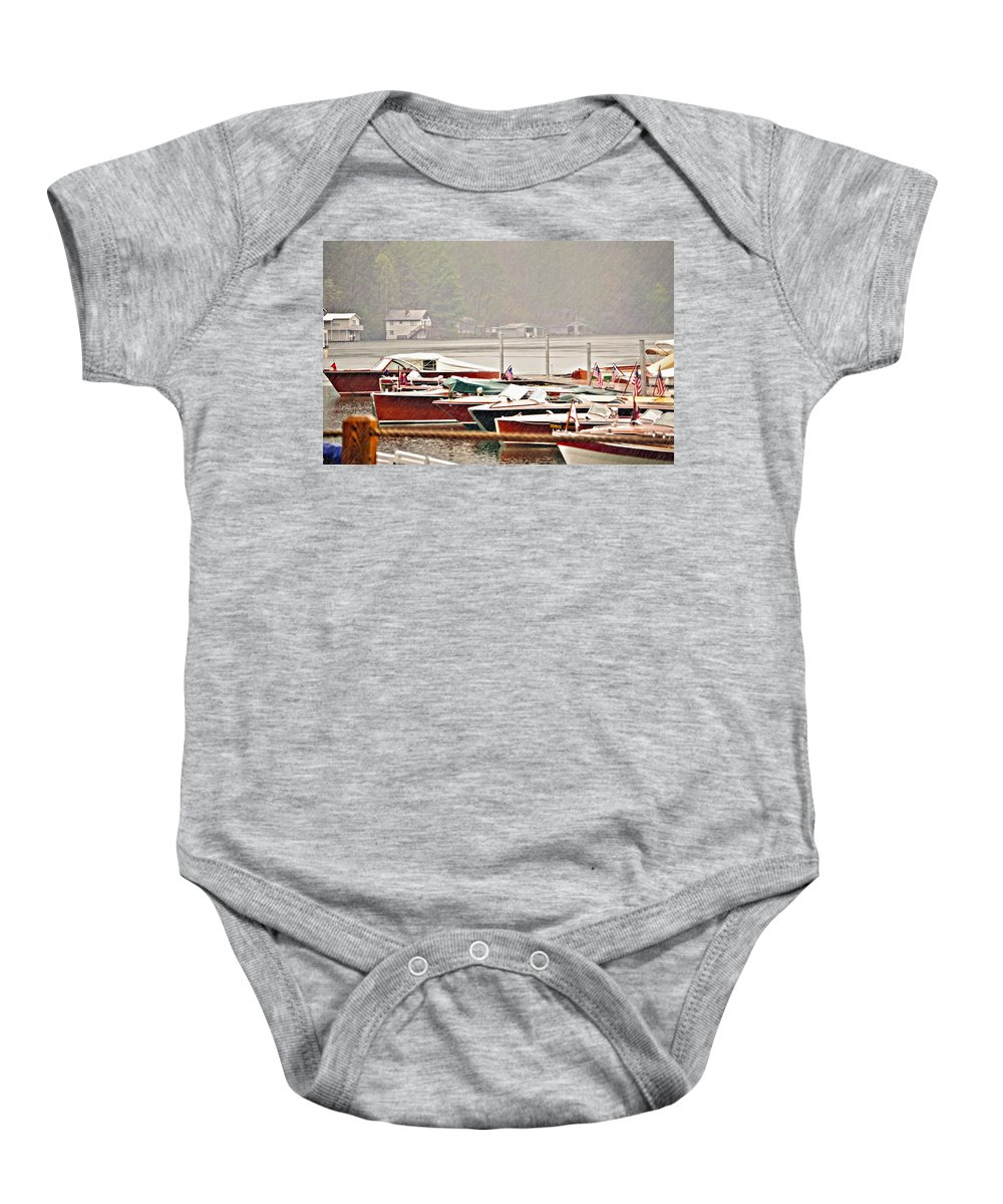 Antique Baby Onesie featuring the photograph Wood Boats In The Rain by Susan Leggett
