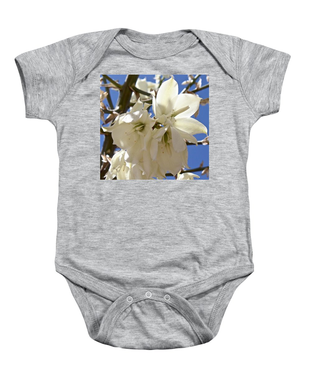 Yucca Baby Onesie featuring the photograph Yucca Flowers by Kume Bryant