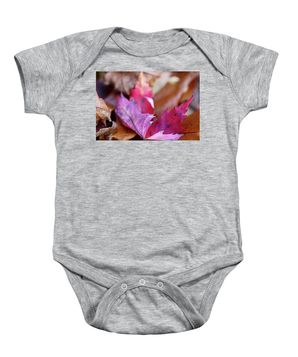 Fall Baby Onesie featuring the photograph Ephemeral Smile by Michiale Schneider