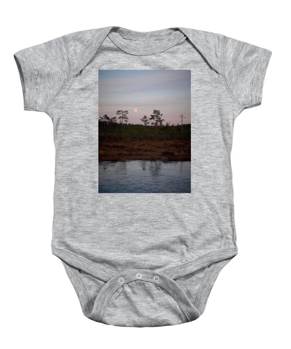 Lehtokukka Baby Onesie featuring the photograph Moon Over Wetlands by Jouko Lehto
