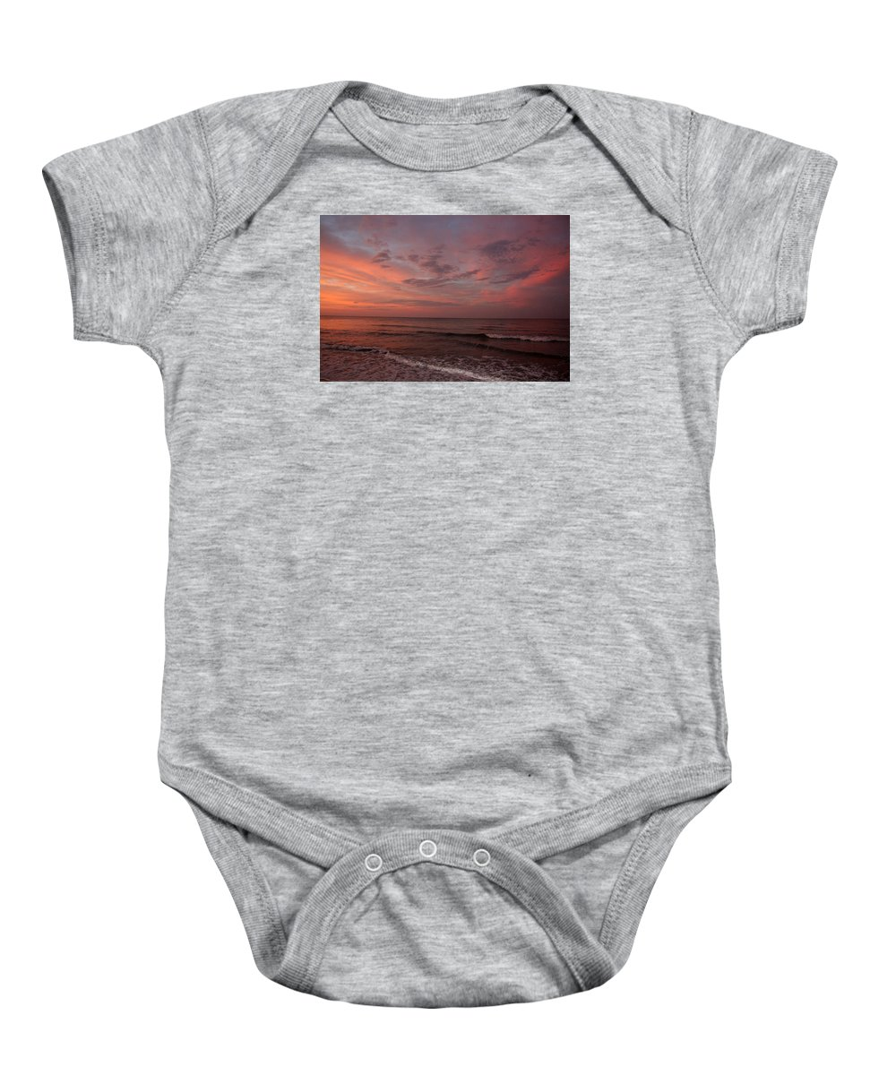 Beach Sunrise. Baby Onesie featuring the photograph Morning At The Beach by Bill Arthur