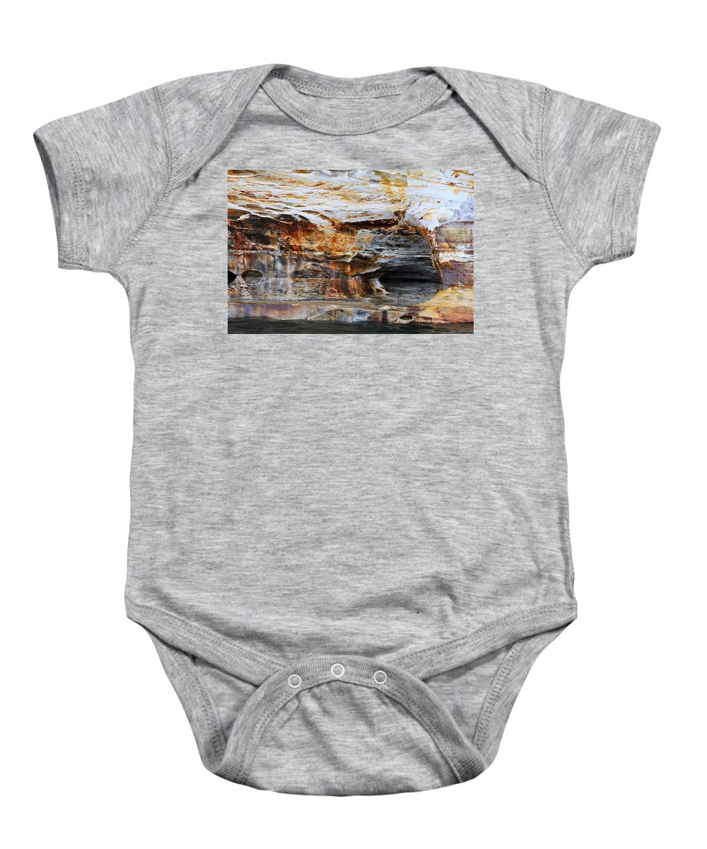 Baby Onesie featuring the pyrography Pictured Rocks by Denise Cornetet