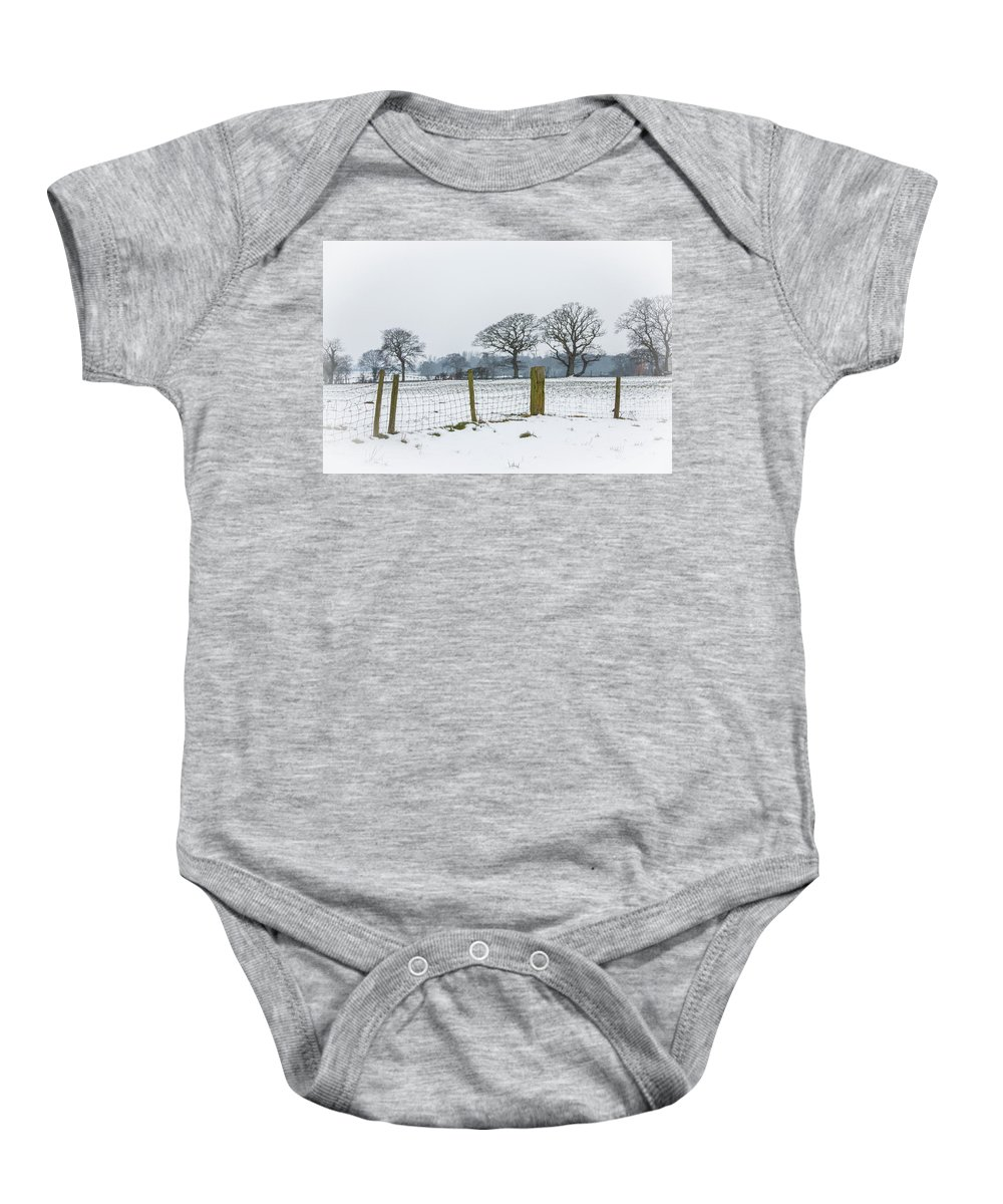 Snow Baby Onesie featuring the photograph Standing In The Snow by Raelene Goddard