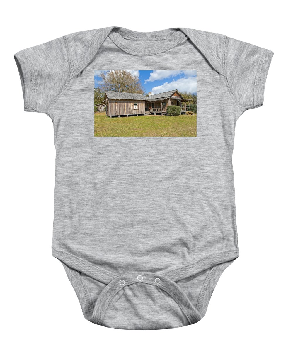 Cabin Baby Onesie featuring the photograph 1912 Simmons Farm In Christmas Florida by Allan Hughes