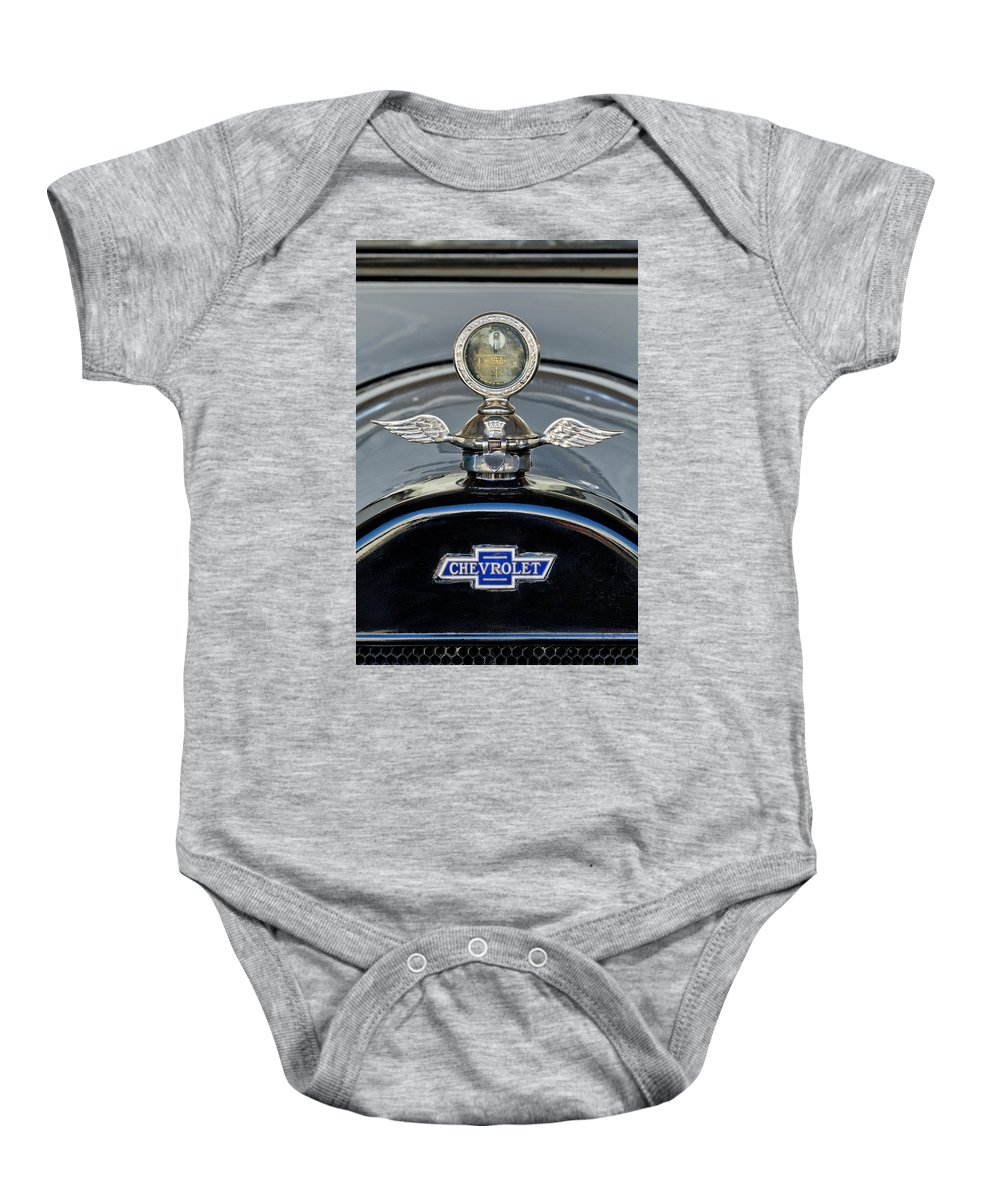 1915 Chevrolet Touring Baby Onesie featuring the photograph 1915 Chevrolet Touring Hood Ornament 2 by Jill Reger