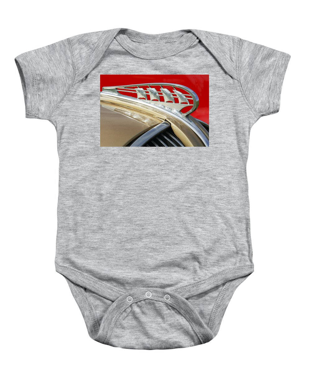 Car Baby Onesie featuring the photograph 1938 Plymouth Hood Ornament by Jill Reger