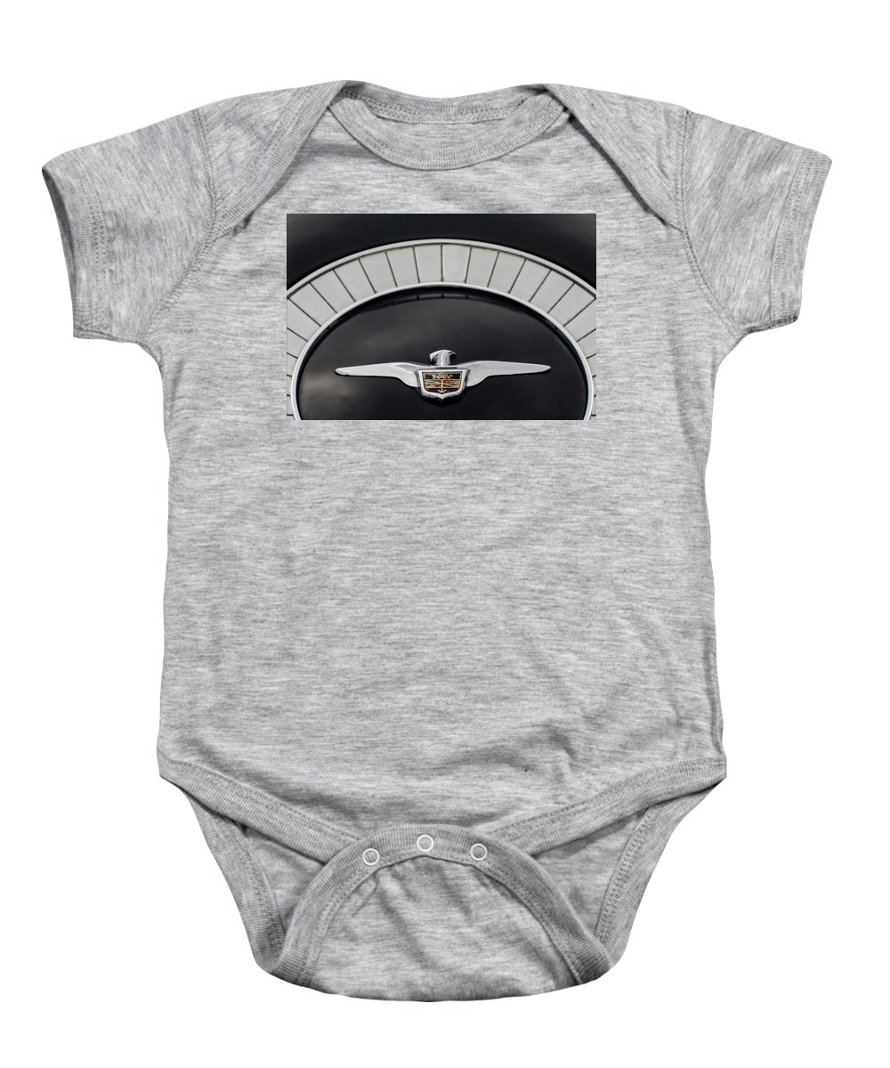 1958 Chrysler Imperial Emblem Baby Onesie featuring the photograph 1958 Chrysler Imperial Emblem by Jill Reger