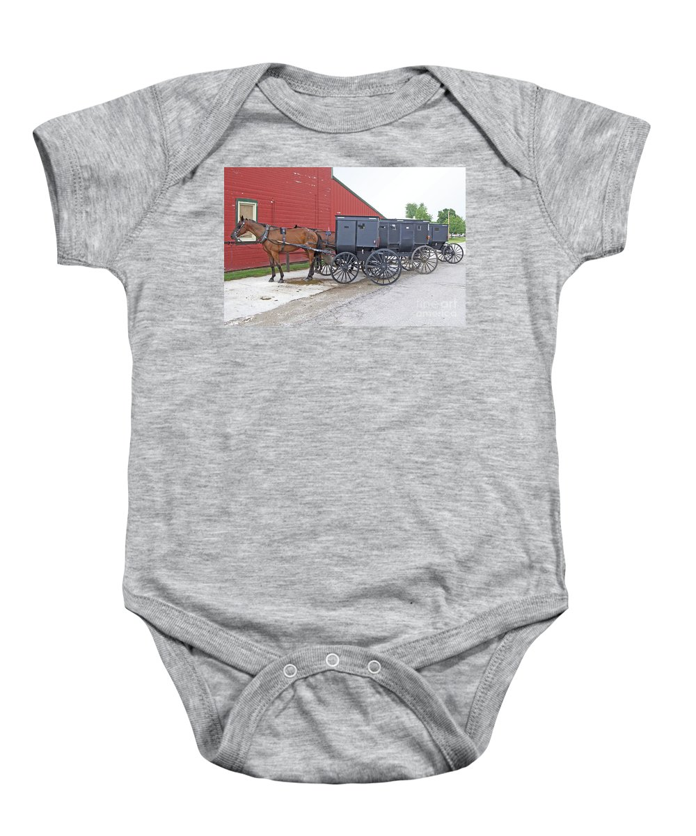 Amish Baby Onesie featuring the photograph Amish Parking Lot by Ann Horn