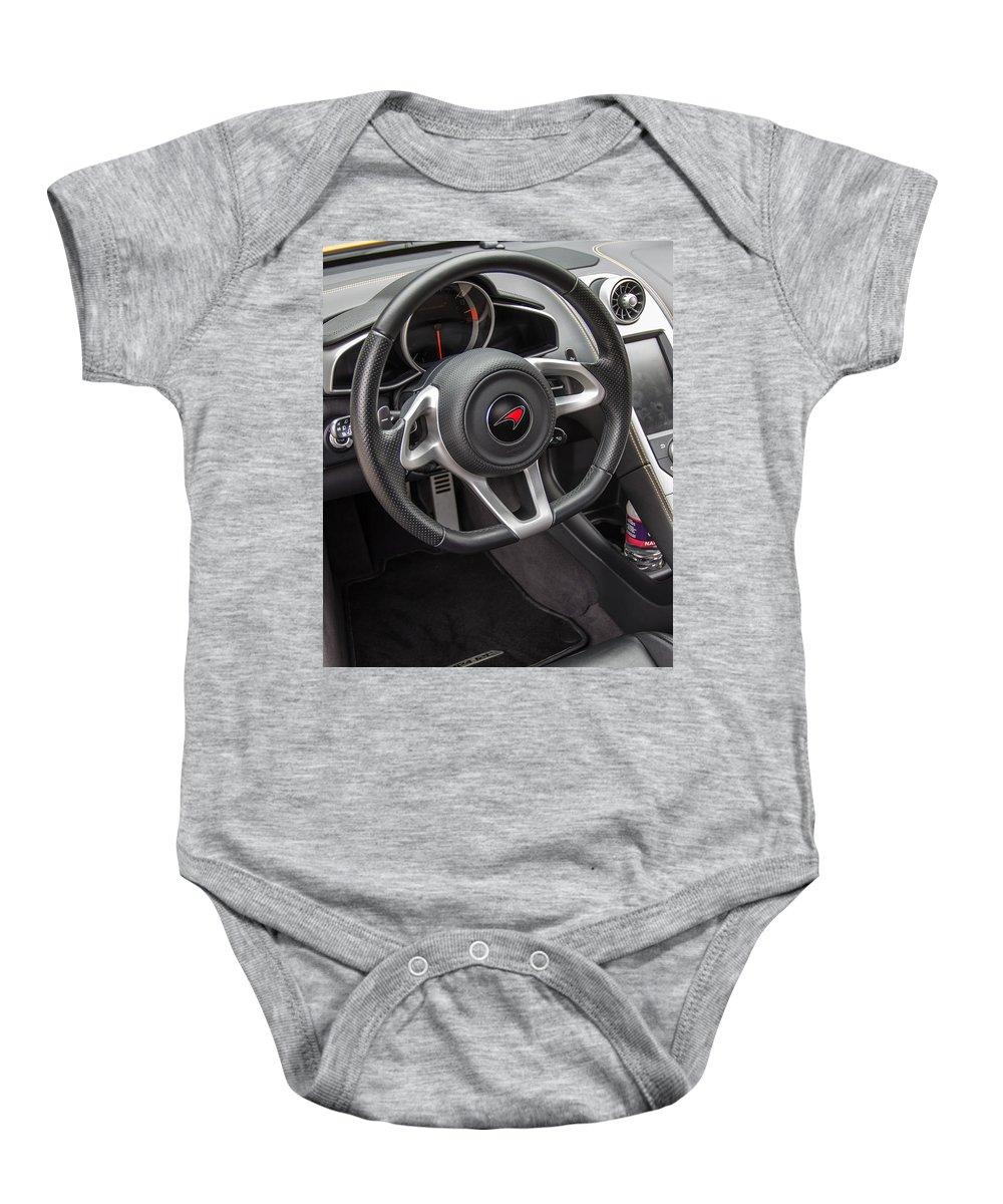 2012 Baby Onesie featuring the photograph 2012 Mc Laren Steering Wheel by Robert Kinser