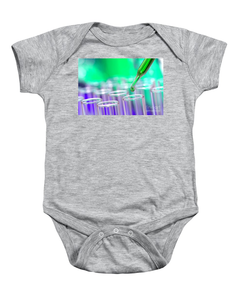 Chemical Baby Onesie featuring the photograph Laboratory Test Tubes In Science Research Lab by Olivier Le Queinec