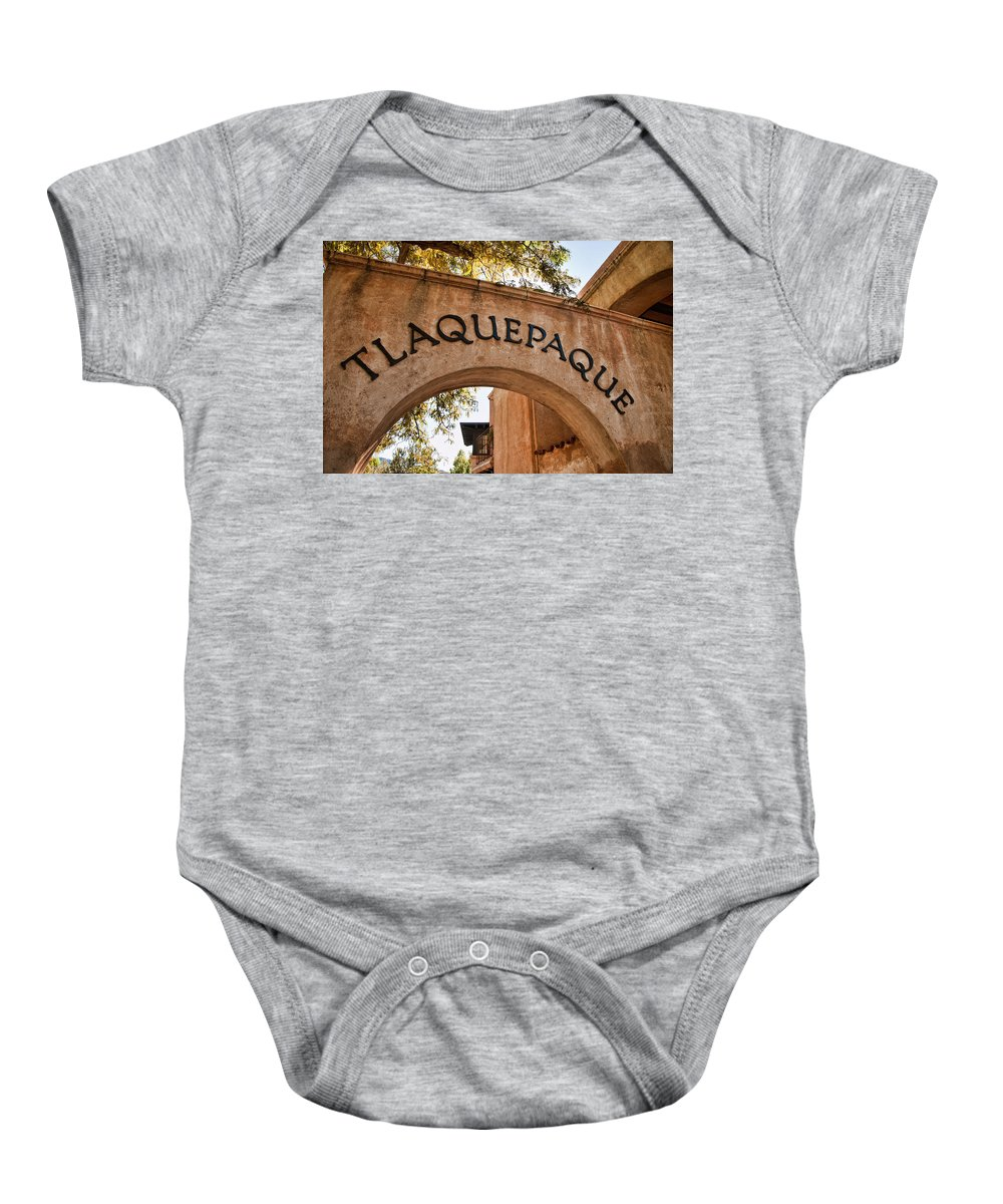 Sedona Tlaquepaque Shopping Center Baby Onesie featuring the photograph Sedona Tlaquepaque Shopping Center by Jon Berghoff