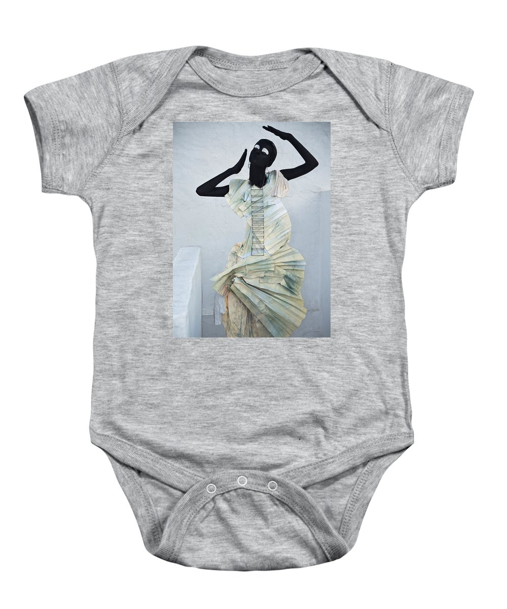 Black Baby Onesie featuring the photograph Woman With Black Boby Paint In Paper Dress by Veronica Azaryan