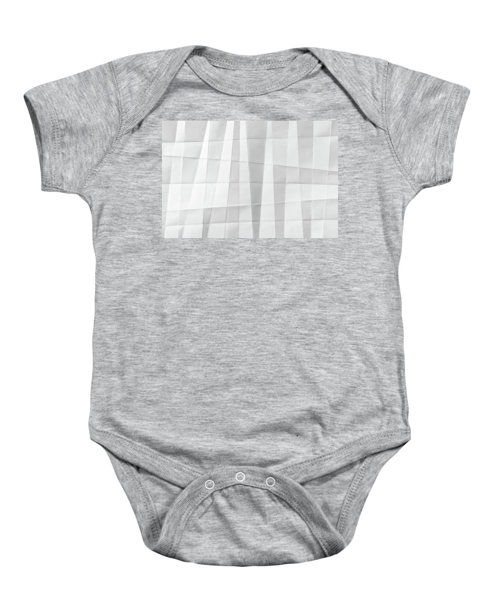 Abstract Baby Onesie featuring the photograph White Folded Paper by Alain De Maximy