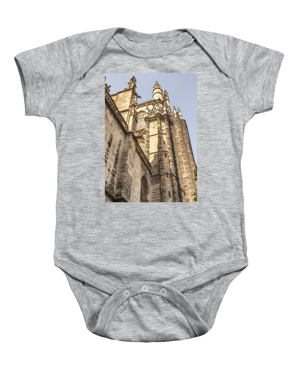 Cathedral Of Seville Baby Onesie featuring the photograph Cathedral Of Seville - Seville Spain by Jon Berghoff