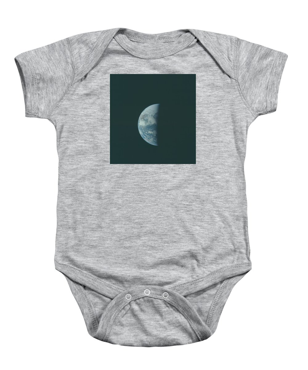 Space Baby Onesie featuring the pyrography Earth The Blue Marble by Artistic Panda