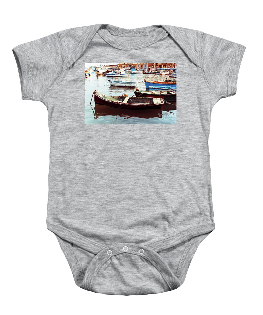 Malta Baby Onesie featuring the photograph Traditional Boats At Marsaxlokk Harbor In Malta by Otto