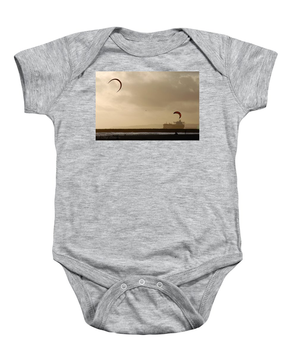 Clay Baby Onesie featuring the photograph A Day At The Beach by Clayton Bruster