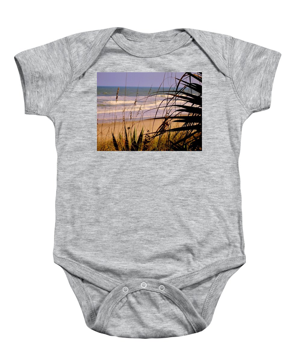 Peek At The Shore Baby Onesie featuring the photograph A Peek At The Shore by Susanne Van Hulst