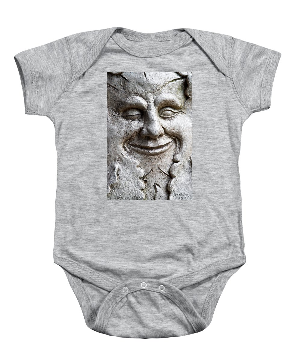 Sculpture Baby Onesie featuring the photograph A Wink And A Smile by Christopher Holmes
