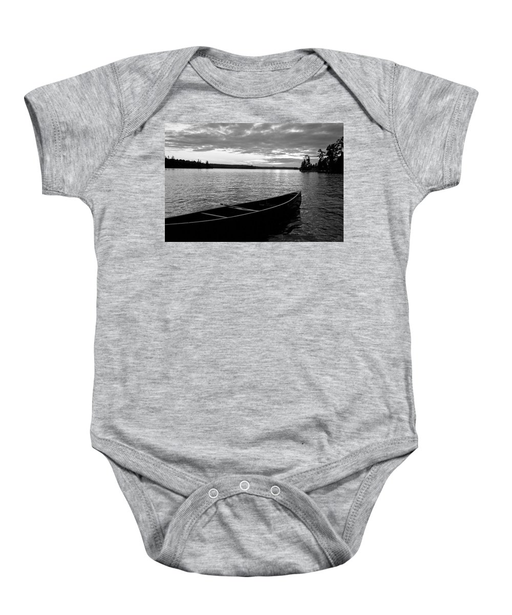Absence Baby Onesie featuring the photograph Abandoned Canoe Floating On Water by Keith Levit