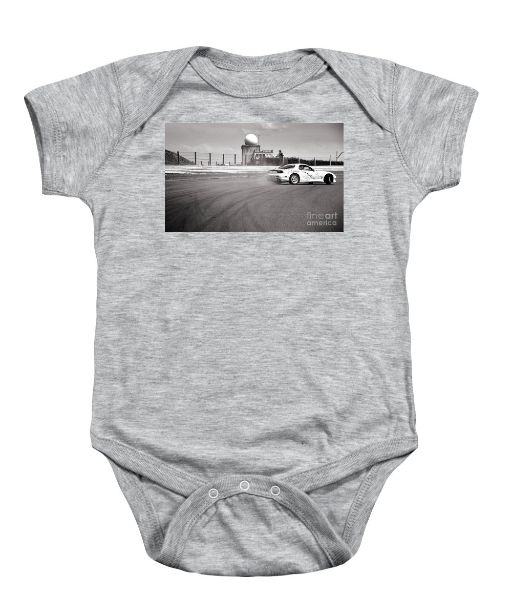 Car Baby Onesie featuring the photograph Airfield Drifting by Andy Smy
