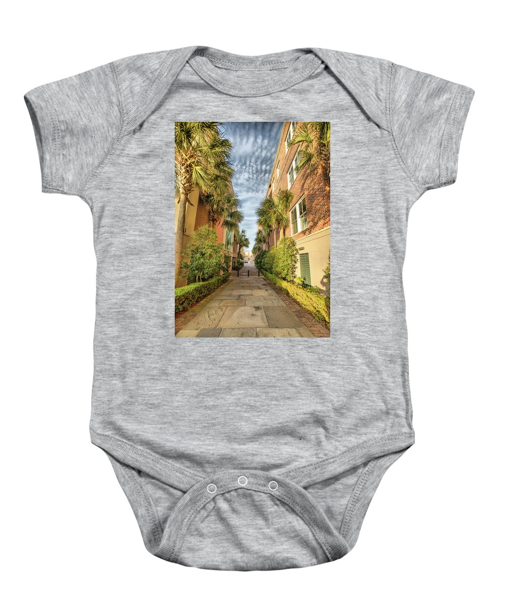 Charleston Baby Onesie featuring the photograph Alleyway In Chaleston by Lynne Jenkins