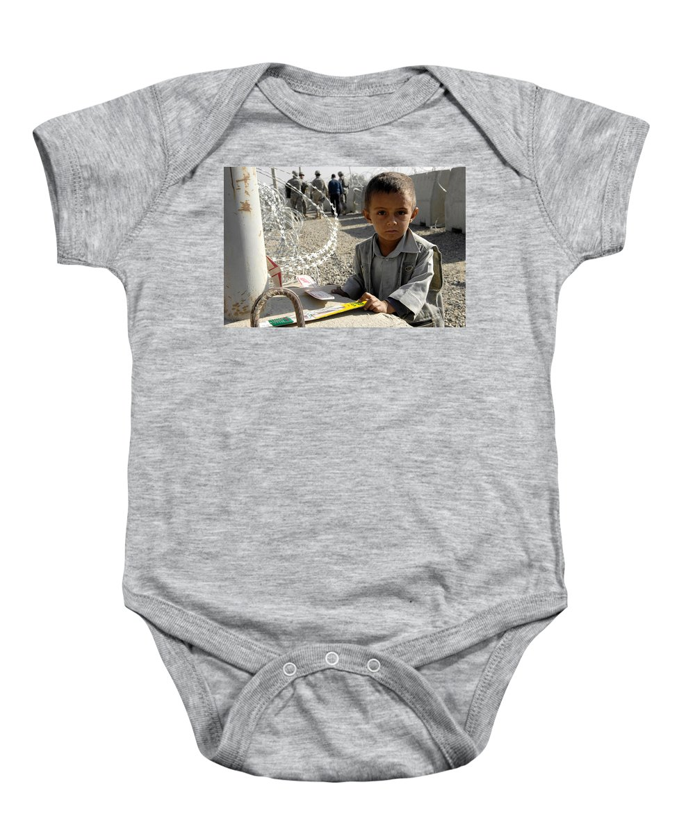 An Afghan Child Baby Onesie featuring the painting an Afghan child by Eastern Accents