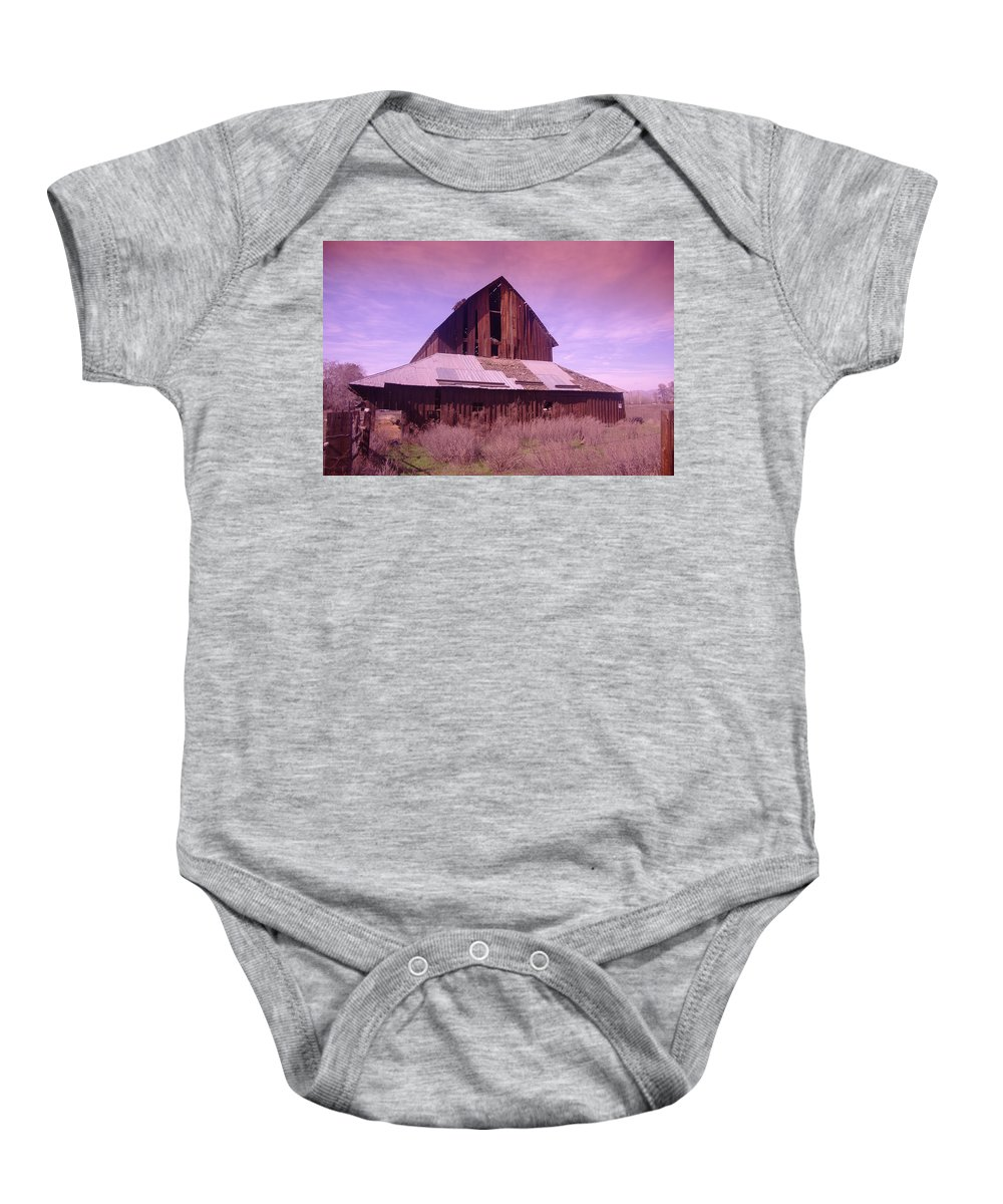 Barns Baby Onesie featuring the photograph An Old Weathered Barn by Jeff Swan