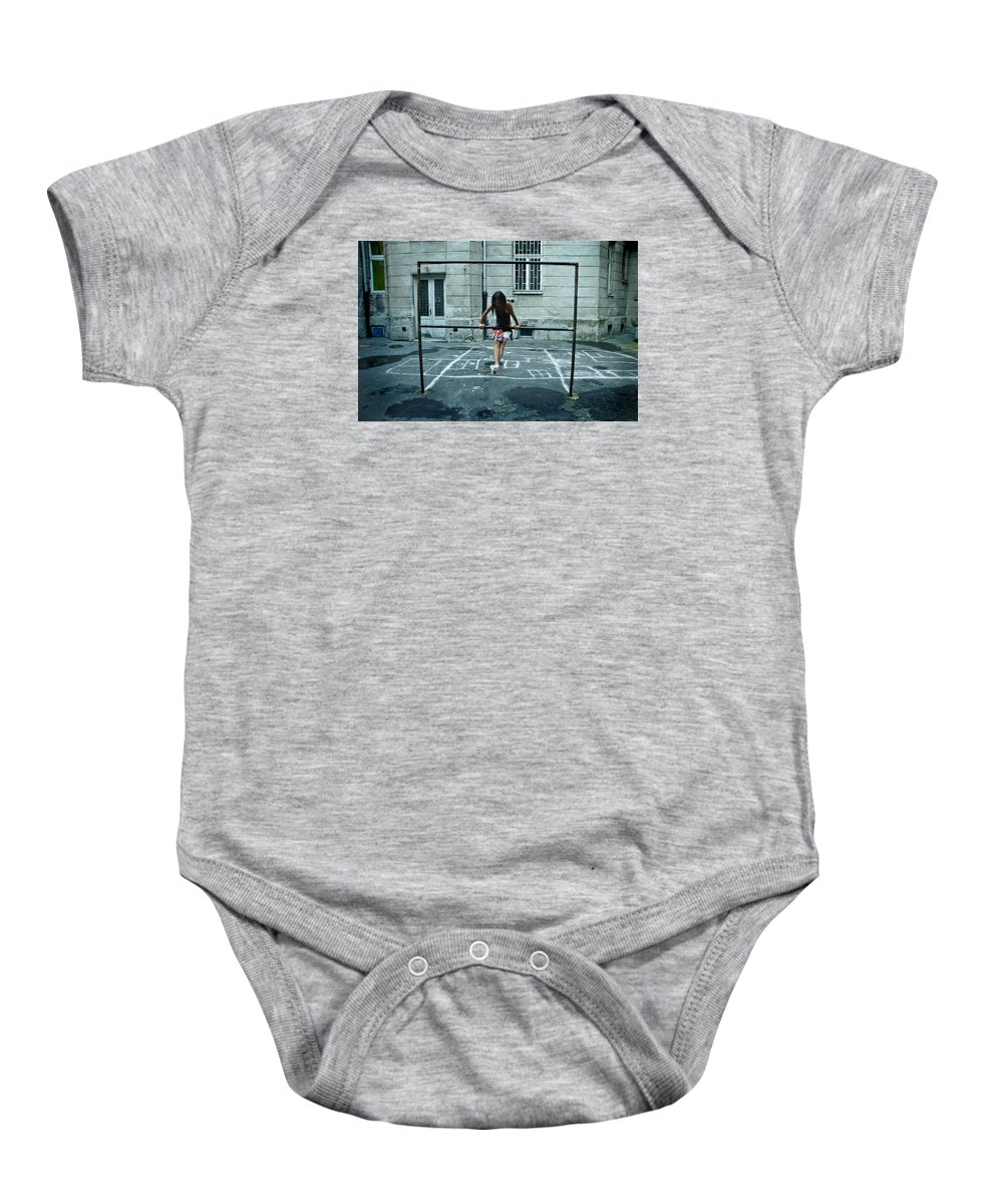 Children Baby Onesie featuring the photograph Ana At The Barre by Michael Ziegler