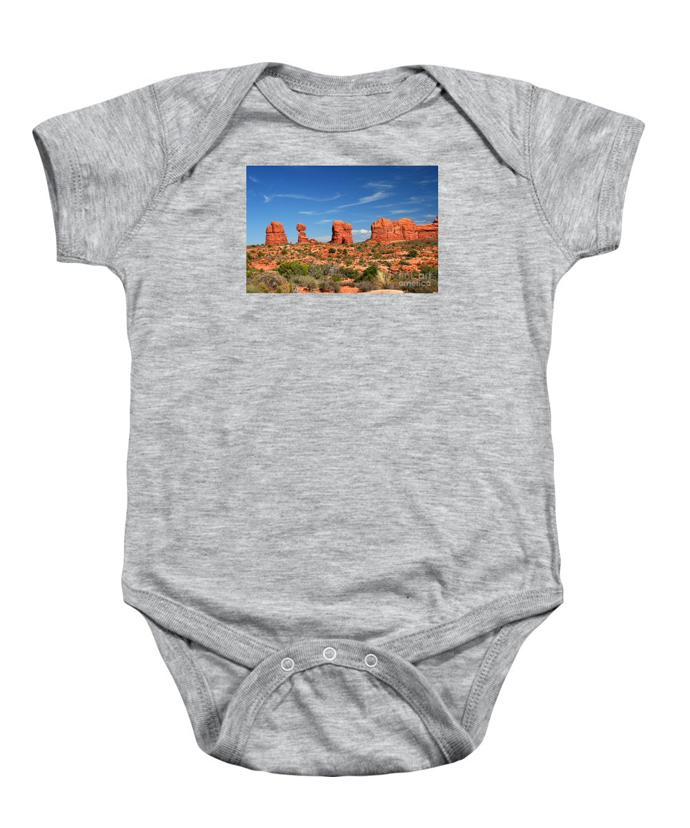 Arches National Park Baby Onesie featuring the painting Arches National Park - Hoodoos Carved In Entrada Sandstone by Corey Ford