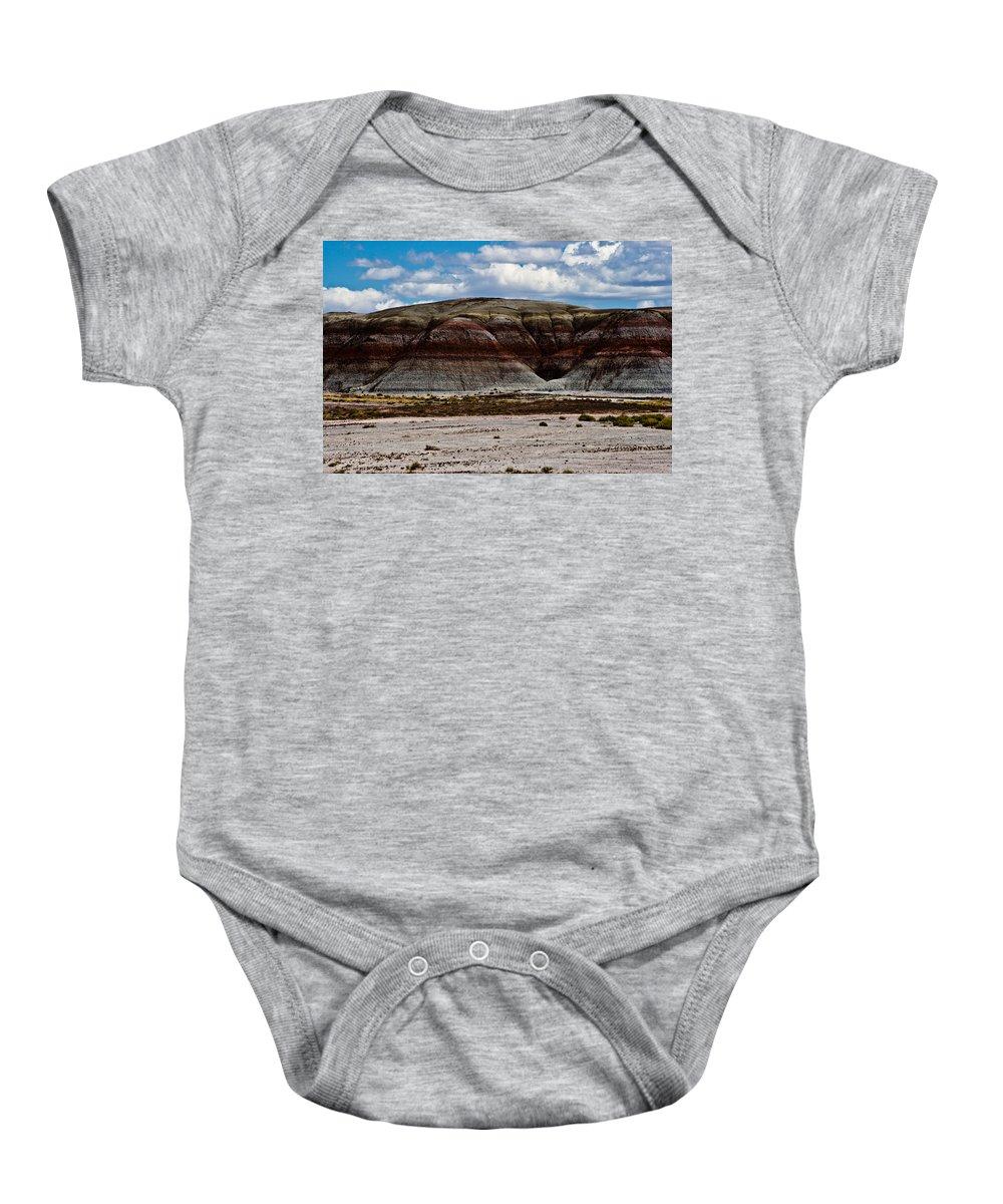 Painted Baby Onesie featuring the photograph Arizona's Painted Desert #3 by Robert J Caputo