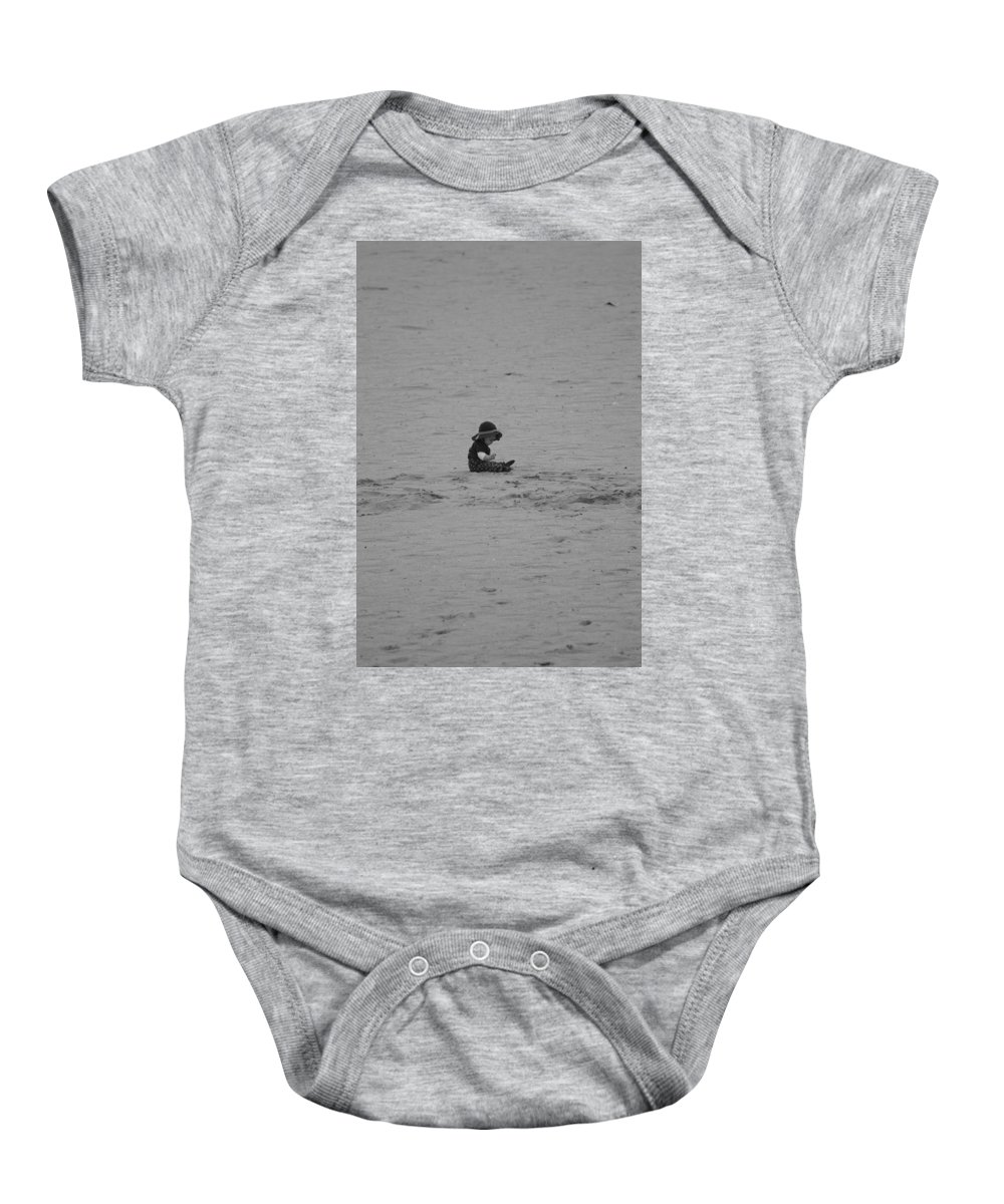 Black And White Baby Onesie featuring the photograph Baby In The Sand by Rob Hans