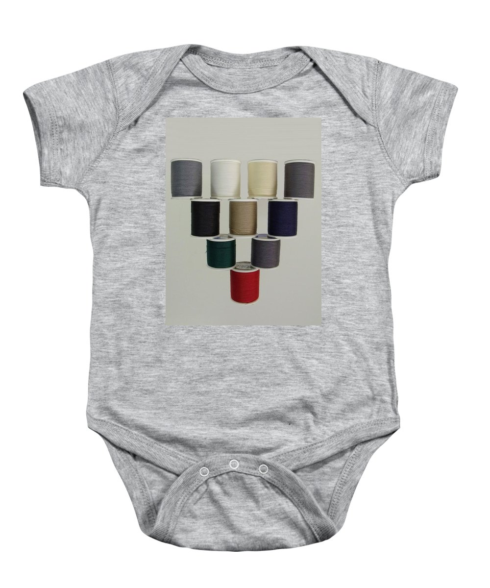Still Life Baby Onesie featuring the photograph Balancing Act by Ed Smith
