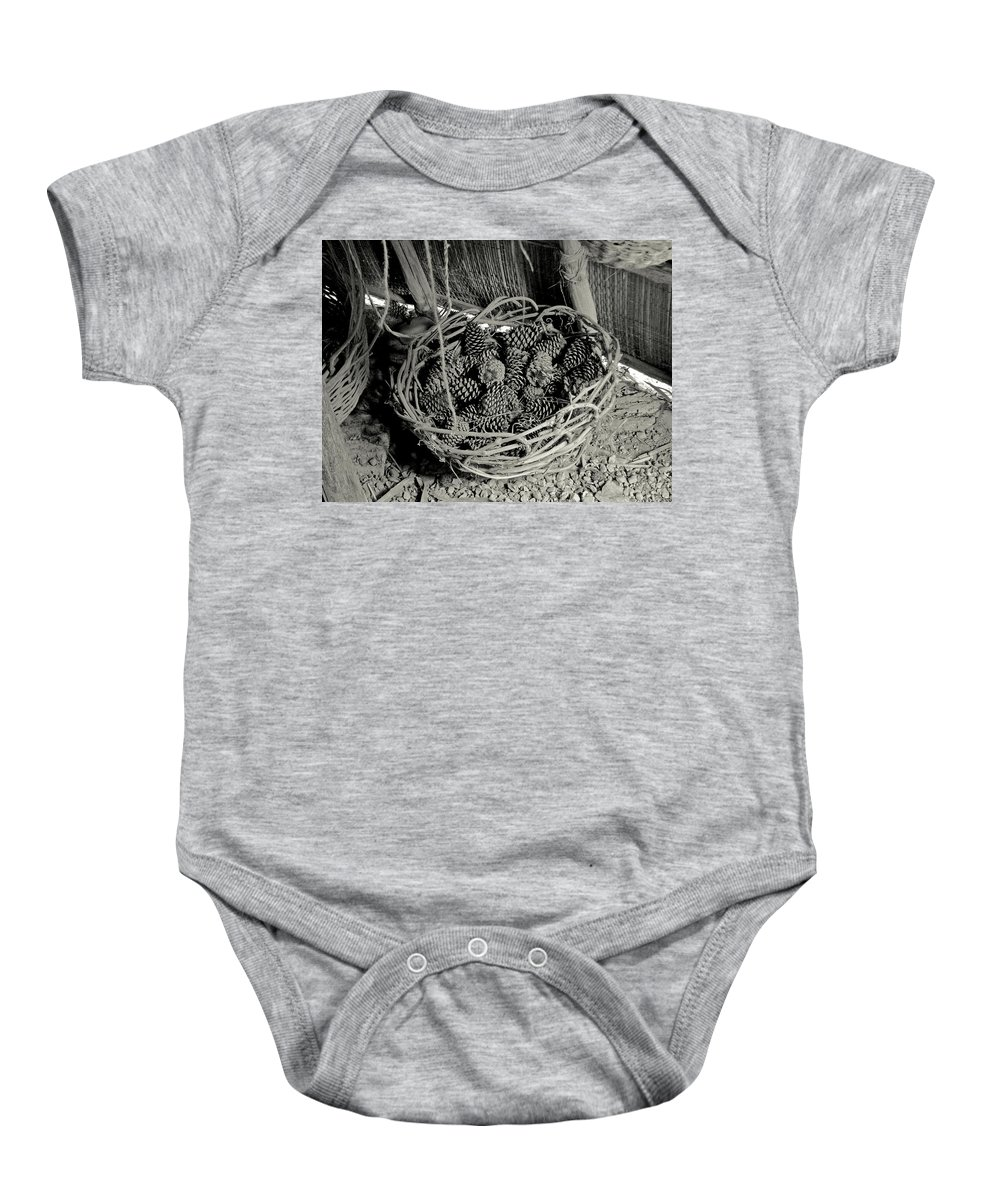 Nature Baby Onesie featuring the photograph Basket Of Pine Cones by Peg urban