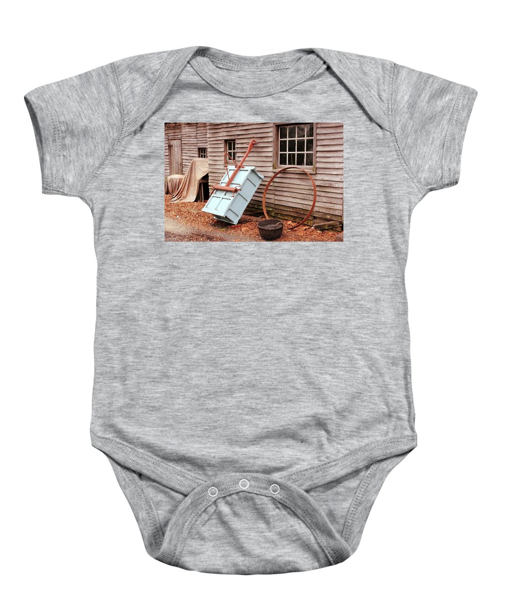 American Baby Onesie featuring the photograph Behind The Blacksmith Shop by Lou Ford