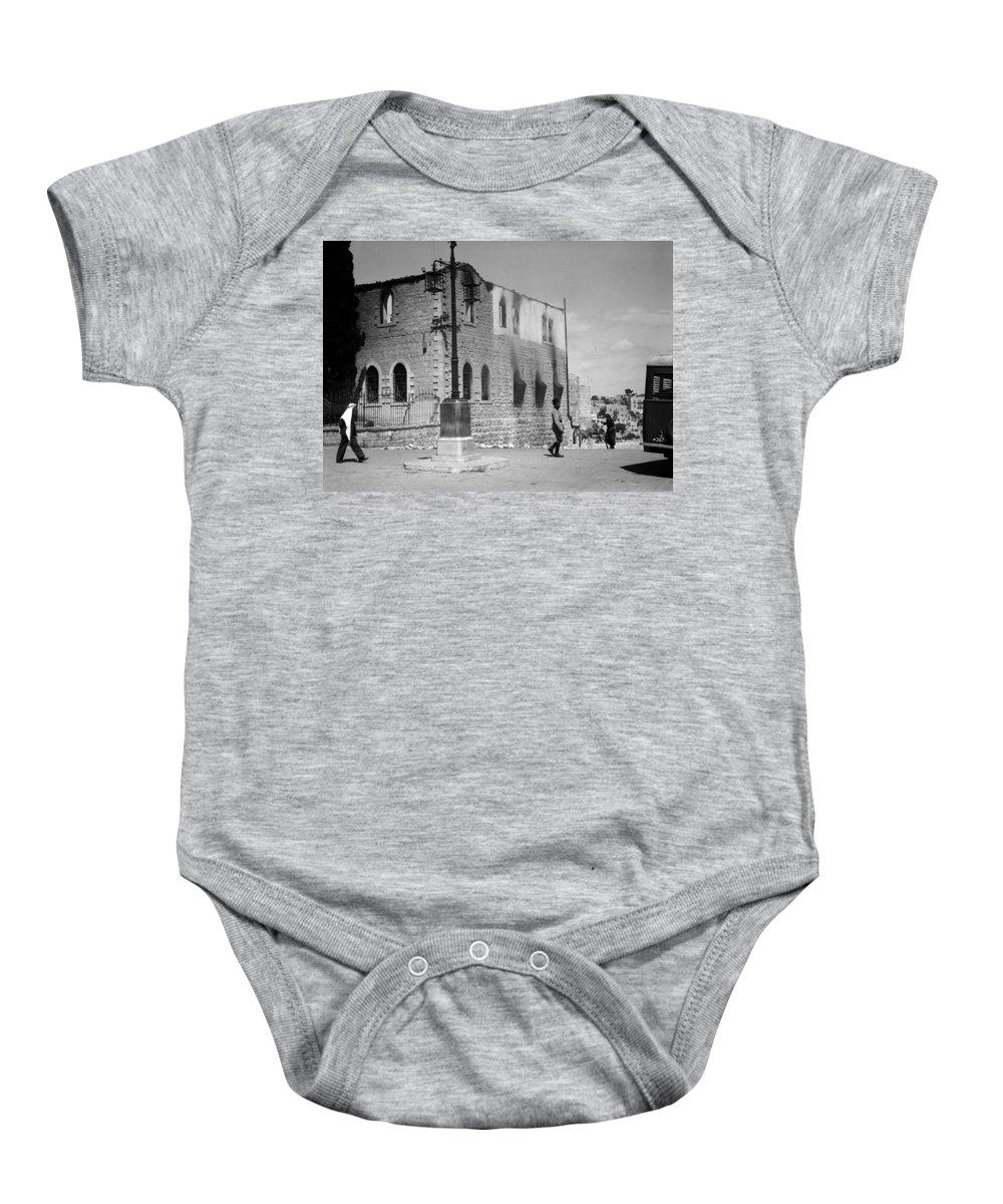 Bethlehem Baby Onesie featuring the photograph Bethlehem Police Barracks Burned Down On 1938 by Munir Alawi