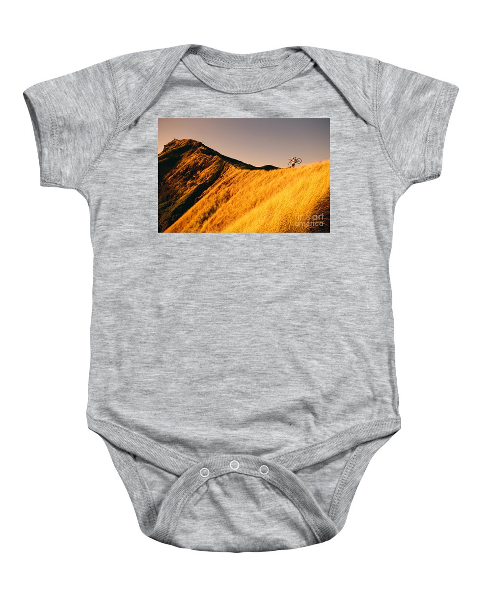 Athletic Sports Art Baby Onesie featuring the photograph Biker On The Ridge by Dana Edmunds - Printscapes