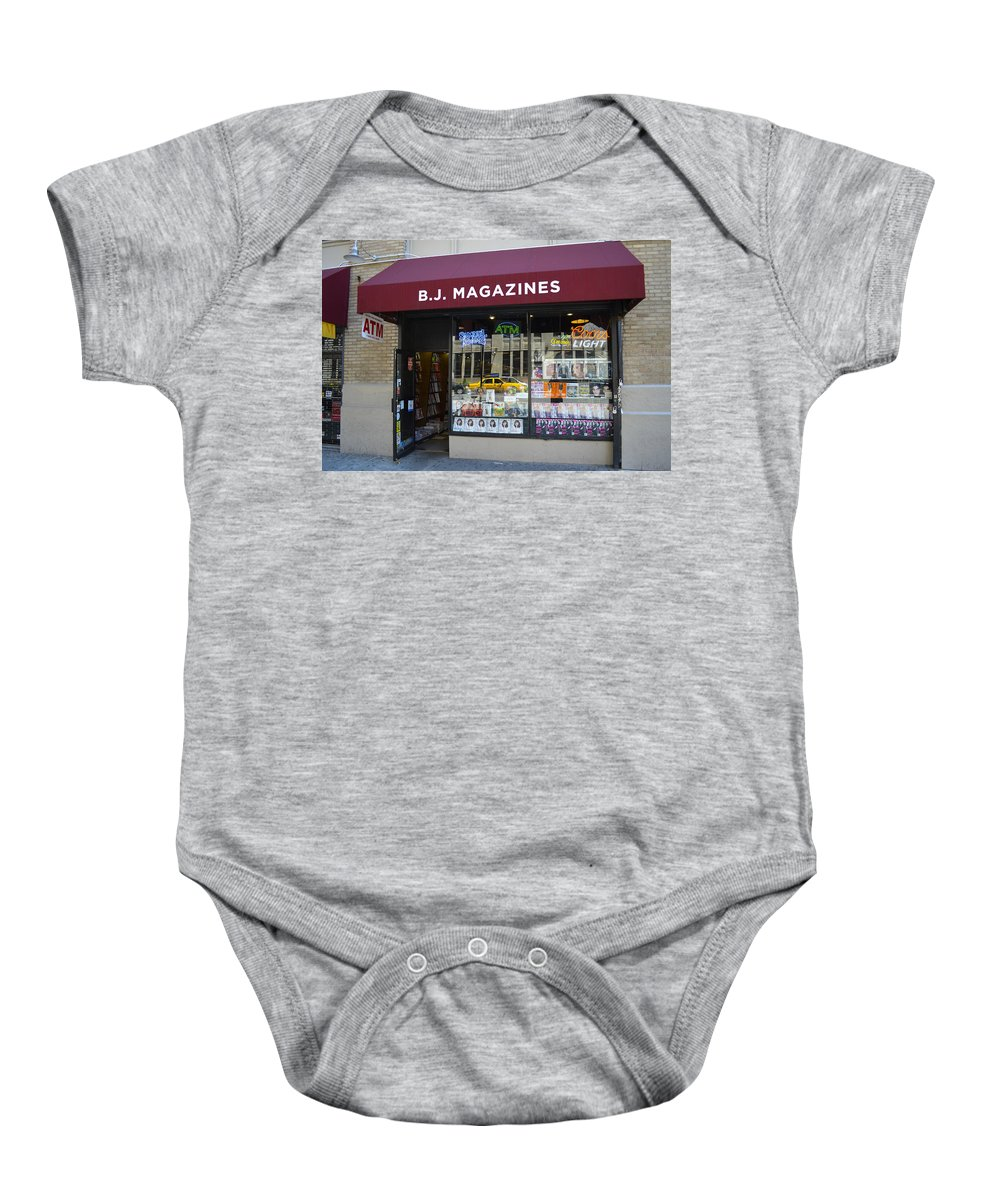 Storefront Baby Onesie featuring the photograph B.j. Magazines New York by Erik Burg