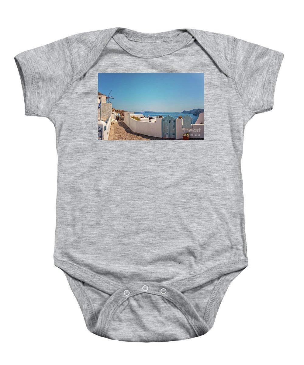 Sun Baby Onesie featuring the photograph Blue Gate Santorini by Sophie McAulay