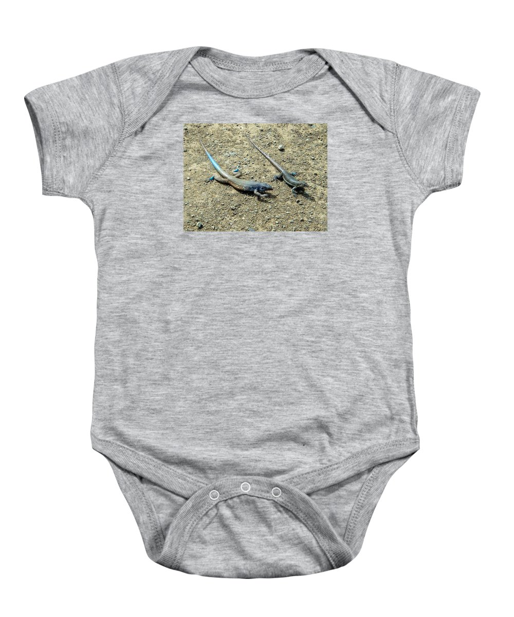Bonaire Baby Onesie featuring the photograph Blue Lizards by June Goggins