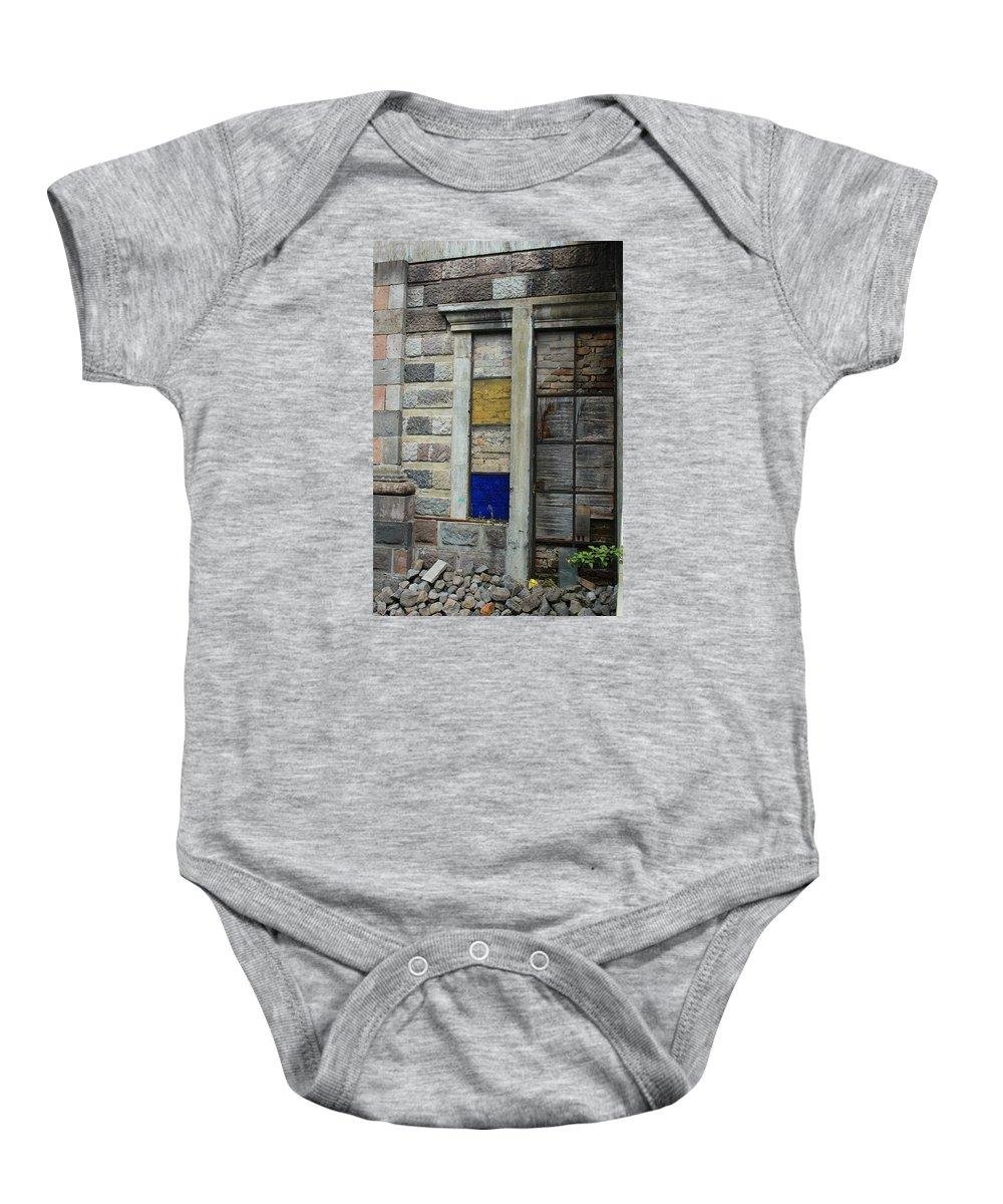 Window Baby Onesie featuring the photograph Broken Glass Window With Bricks by Robert Hamm