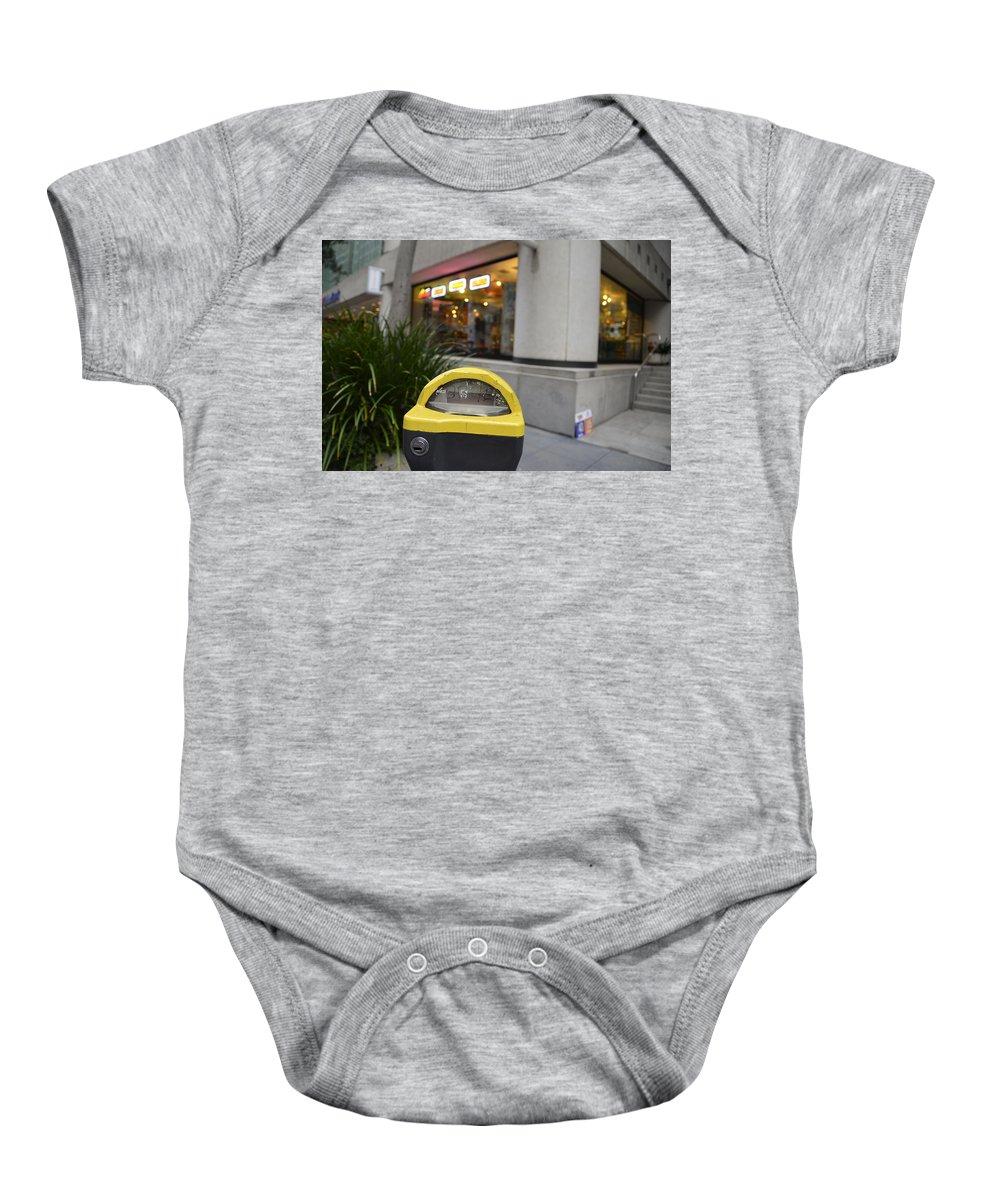 Street Baby Onesie featuring the photograph Broken Meter by Erik Burg