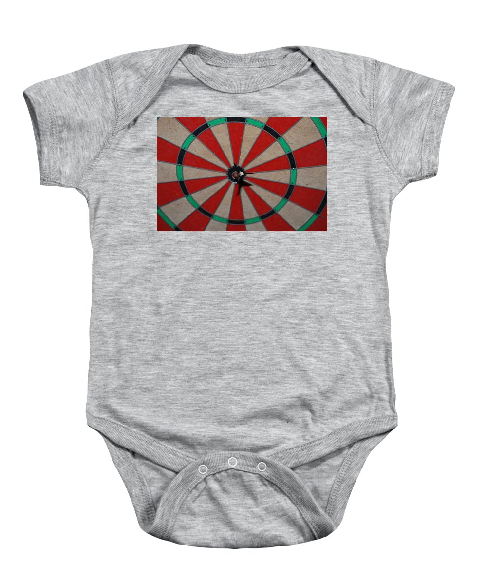Macro Baby Onesie featuring the photograph Bulls Eye by Rob Hans